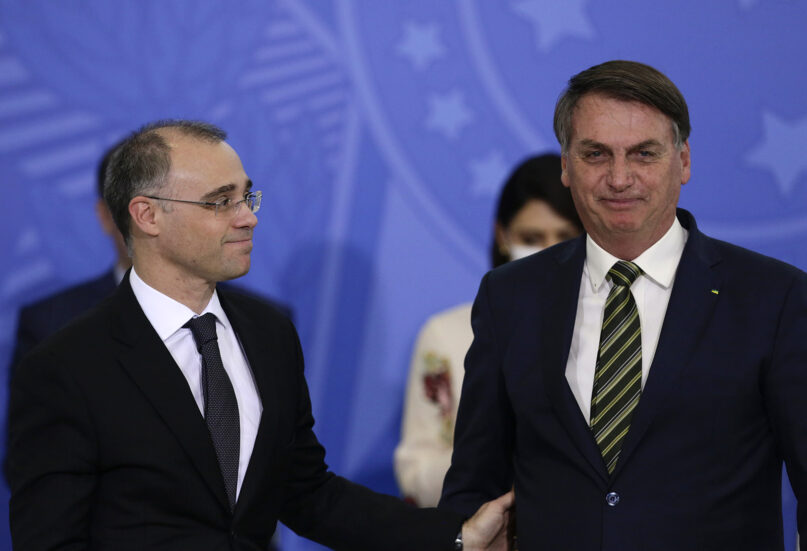 Brazil President Jair Bolsonaro, right, and his new justice minister, André Mendonça, attend his swearing-in ceremony at the Planalto presidential palace, in Brasilia, Brazil, on April 29, 2020. (AP Photo/Eraldo Peres)