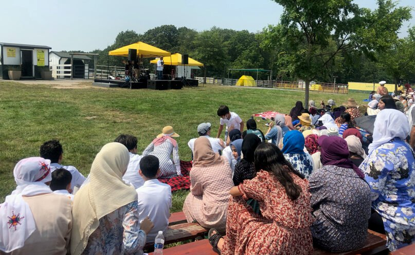 People listen to a Native Deen concert during an Eid al-Adha celebration at the Green Meadows Petting Farm in Ijamsville, Maryland, July 20, 2021. Photo courtesy of Laila Tauqeer