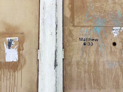 Matthew 6:33 etched on the boarded-up entrance of the church. RNS Photo by Alejandra Molina