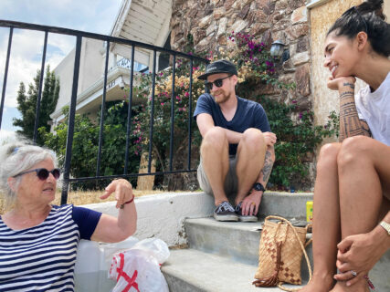 From left, Ingrid Mueller, Chase Cole and Stephanie Serra talk outside First Baptist Church on Sunday, July 11. Several members of the community are hoping to restore the church. RNS photo by Alejandra Molina