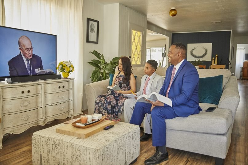 The Hill family watches services on their TV for a baptism during digital services in 2020. Photo courtesy of Jehovah's Witness