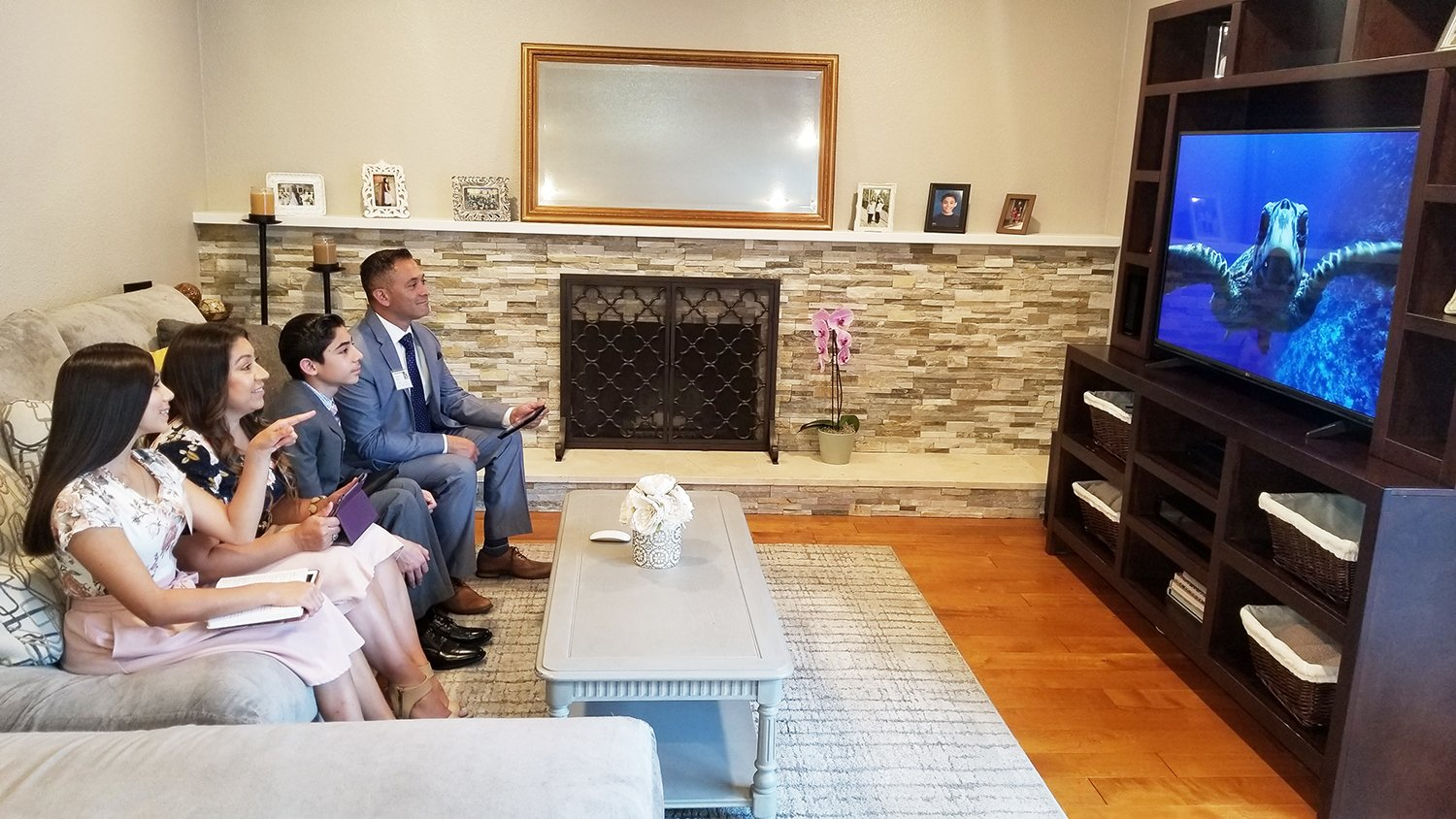 The Huiltron family sits together on the couch to watch a virtual convention in 2020. Because of COVID-19, services shifted to online and will continue online based on a recent announcement. Photo courtesy of Jehovah's Witness
