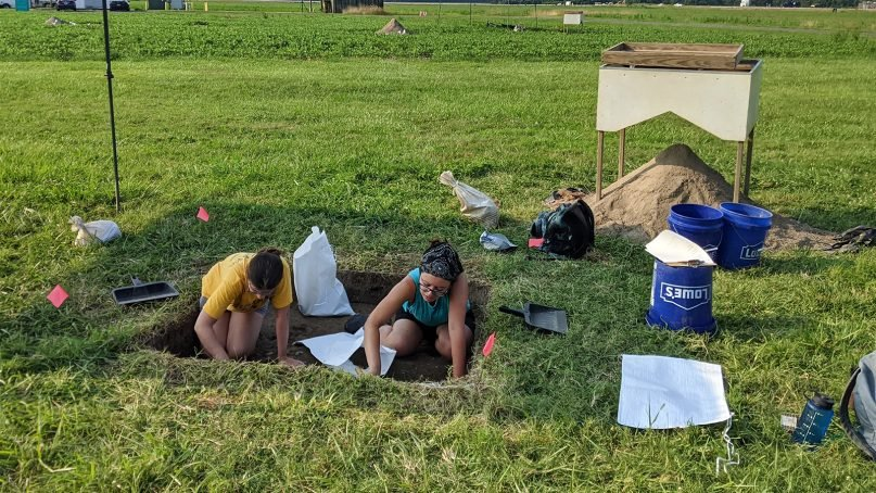 Field Technicians Colleen Betti, left, and Danielle Harris-Burnett participate in an archeological dig at a former plantation in St. Inigoes, in southern Maryland, Wednesday, July 7, 2021. Photo by Ken Homan, SJ