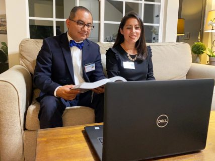 Joel and Terry Hernandez join in the virtual convention from their couch. Photo courtesy of Jehovah's Witness