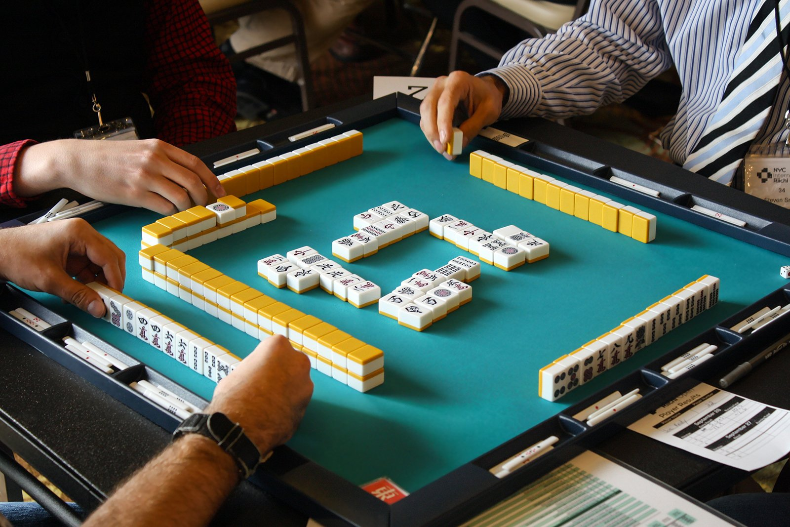 People play a game of mahjong. Image by LazarCatt/Pixabay/Creative Commons