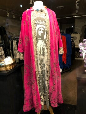 A Virgin Mary inspired dress stands on display in the front window of a shop in Rehoboth, Delaware in March 2021. RNS photo