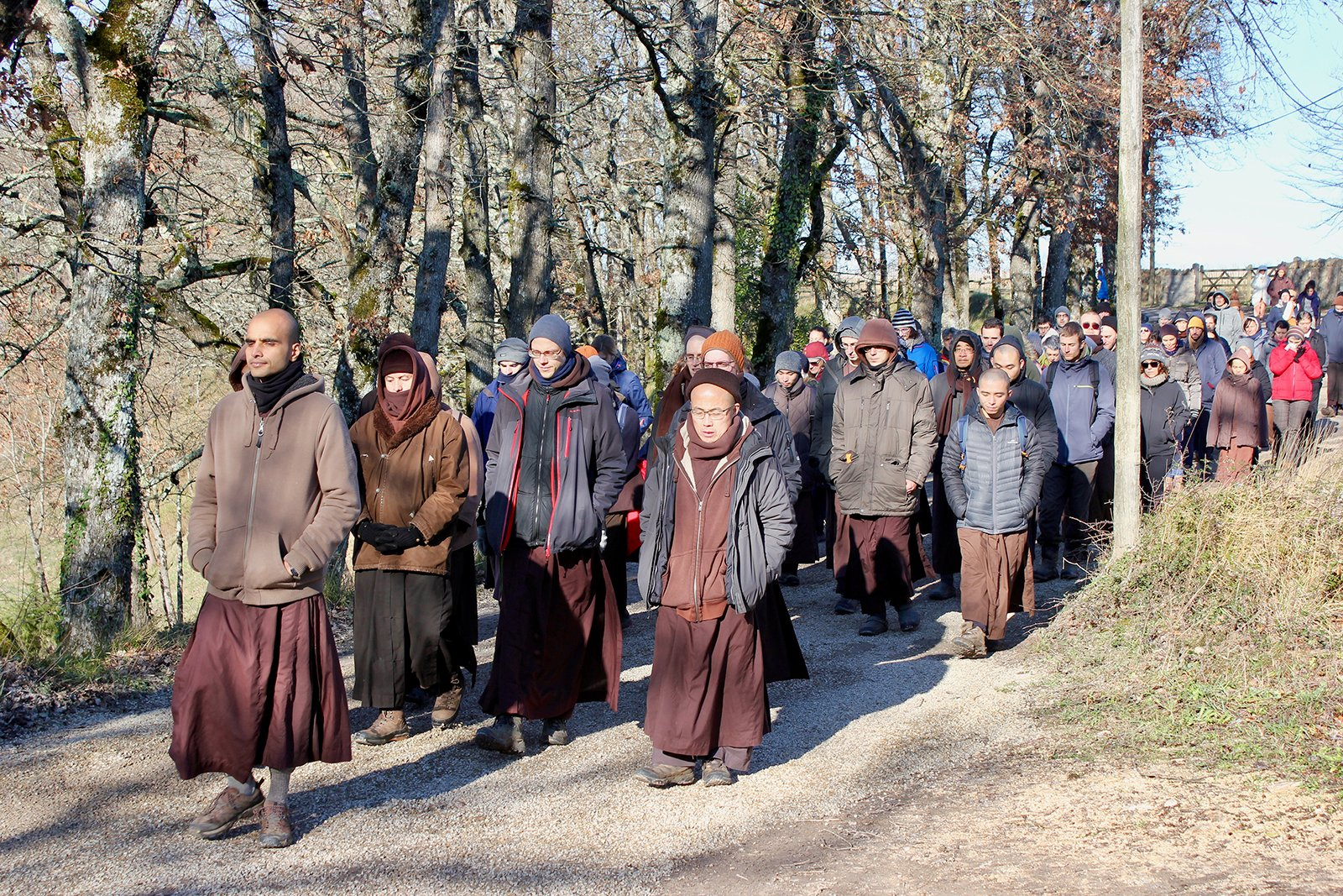 Educators participate in a walking meditation during a Wake Up Schools retreat for educators at the Plum Village mindfulness practice center in the South of France in Dec. 2019. Photo by Megan Sweas