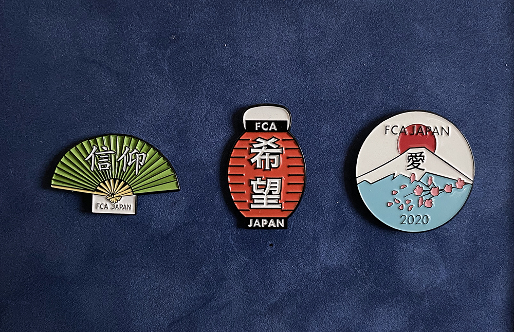 The Fellowship of Christian Athletes Olympics pins include, from left: Faith (信仰), Hope(希望), and Love(愛). Photo courtesy of FCA