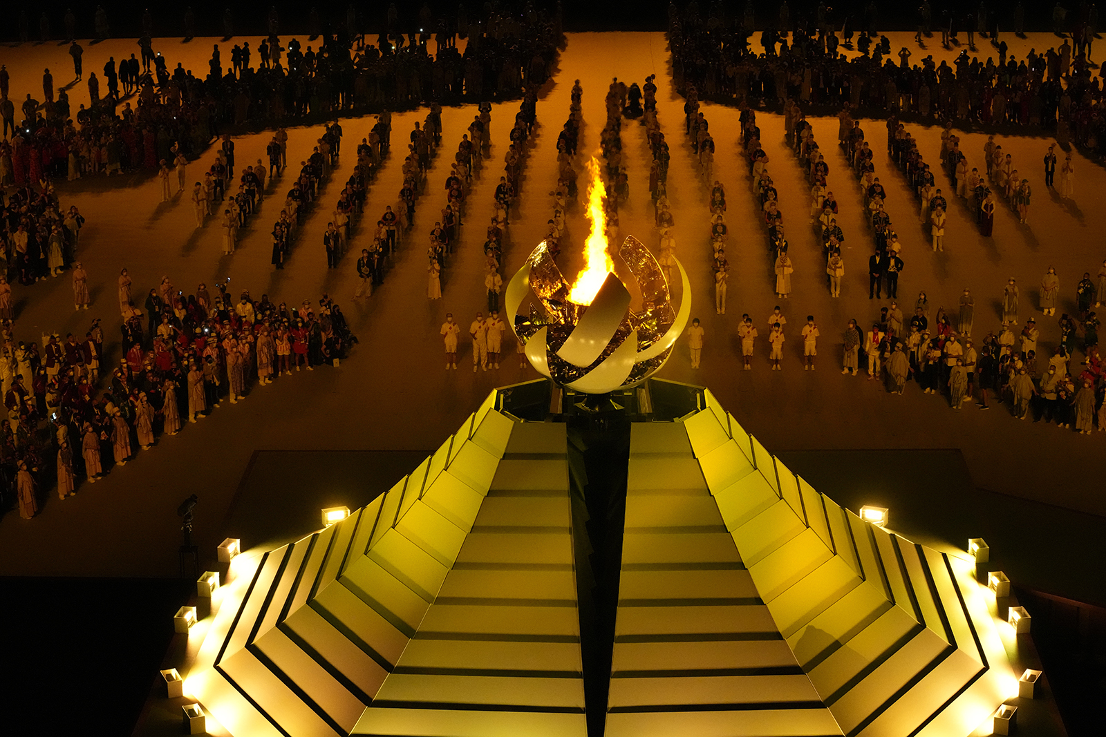 The Olympic flame burns during the opening ceremony in the Olympic Stadium at the 2020 Summer Olympics, July 23, 2021, in Tokyo. (AP Photo/Lee Jin-man)