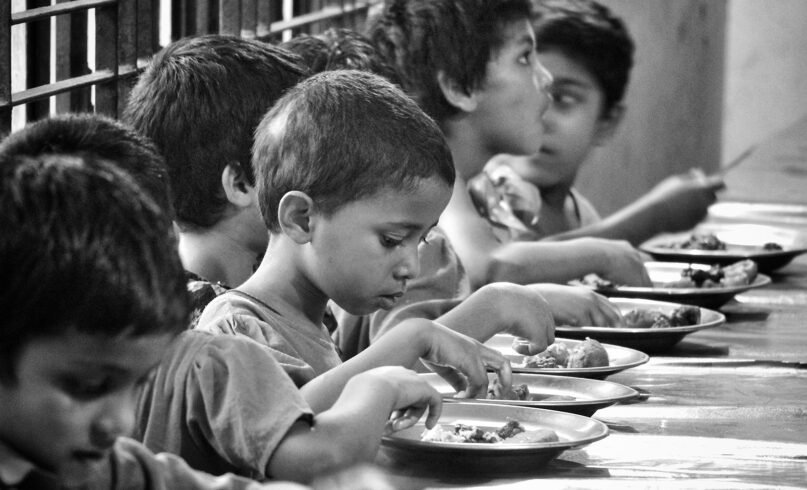 Orphans eat a meal in Sylhet, Bangladesh, in April 2021. Photo by Imdadul Hussain/Unsplash/Creative Commons