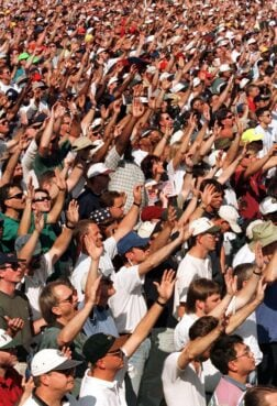 """Men raise their hands in prayer and worship at the Promise Keepers """"Stand in the Gap'' rally on Oct. 4, 1997, at the National Mall in Washington, D.C.. The rally was billed as a """"sacred assembly.'' Photo by Mark Abraham"""