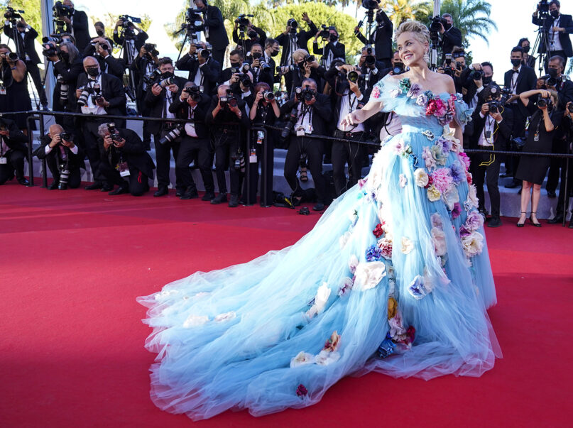 """Sharon Stone poses for photographers upon arrival at the premiere of the film """"The Story of My Wife"""" at the 74th international film festival, Cannes, southern France, July 14, 2021. (AP Photo/Brynn Anderson)"""