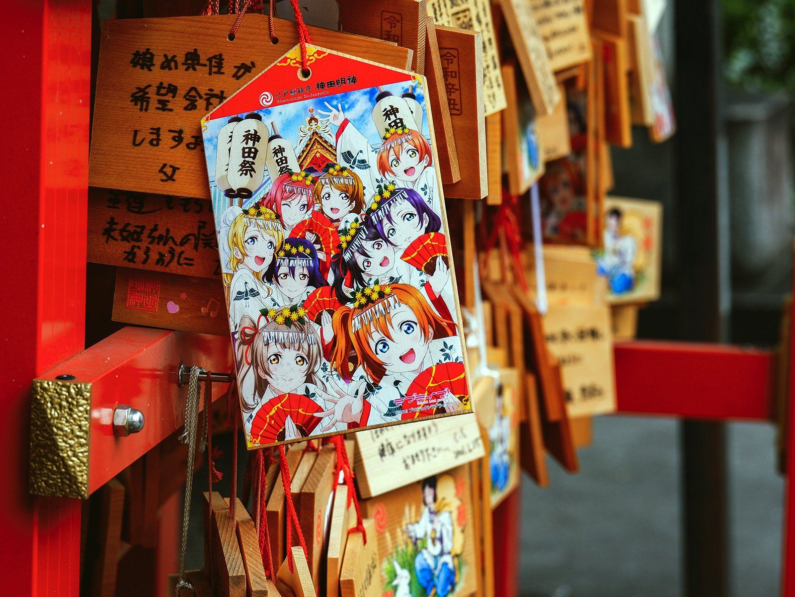 A prayer plaque with anime characters hangs at the Kanda Shinto Shrine in Tokyo, Japan, on July 1, 2021. Photo by Susann Schuster/Unsplash/Creative Commons