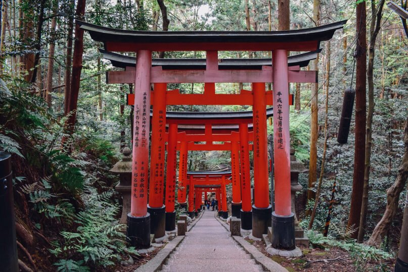 Traditional Japanese torii gates line a stairway in Kyoto, Japan. Torii gates often mark the entrance to a Shinto shrine or sacred space. Photo by Dave Weatherall/Unsplash/Creative Commons
