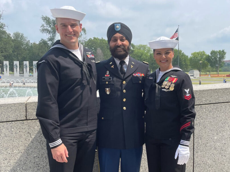 From left, A02 Joe Probasco, LTC Kamal S. Kalsi and A02 Guldeep Kaur stand for a photo near the World War II memorial in Washington D.C. LTC Kalsi is the first Sikh American soldier to have been given a uniform accomodation allowing a beard and dastar - both observed as requirements for Sikh followers. Beards are largely banned for military servicemen in the United States, inspiring conversations about dress code among religious members whose religions forbid shaving. Photo courtesy of Sikh Americans Veterans Alliance