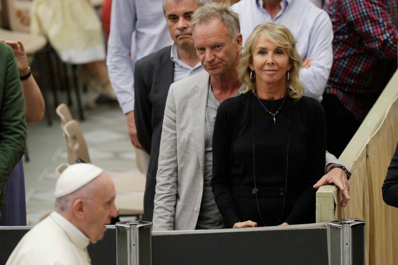 Pope Francis passes by British musician Gordon Sumner, better known as Sting, and his wife, Trudie Styler, as he leaves at the end of his weekly general audience at the Vatican, Aug. 8, 2018. (AP Photo/Gregorio Borgia)