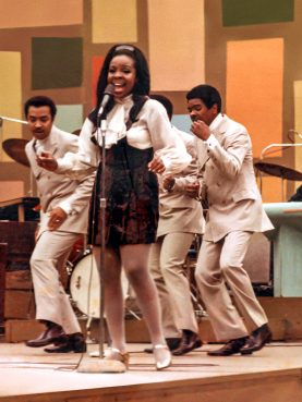 """Gladys Knight & the Pips perform at the Harlem Cultural Festival in 1969, featured in the documentary """"Summer of Soul."""" Photo Courtesy of Searchlight Pictures. © 2021 20th Century Studios. All Rights Reserved."""