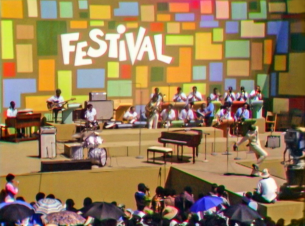 """Tony Lawrence hosts the Harlem Cultural Festival in 1969, featured in the documentary """"Summer of Soul."""" Photo Courtesy of Searchlight Pictures. © 2021 20th Century Studios. All Rights Reserved."""
