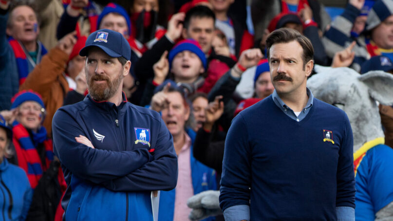 """Brendan Hunt as Coach Beard, left, and Jason Sudeikis as Ted Lasso in the Apple TV+ series """"Ted Lasso."""" Photo courtesy of Apple TV+"""