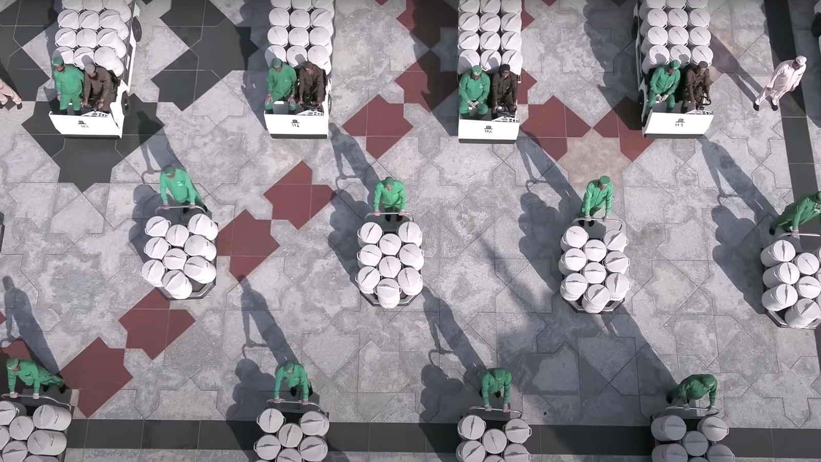 Workers pose with zamzam water coolers for a video in Mecca, Saudi Arabia. Video screengrab