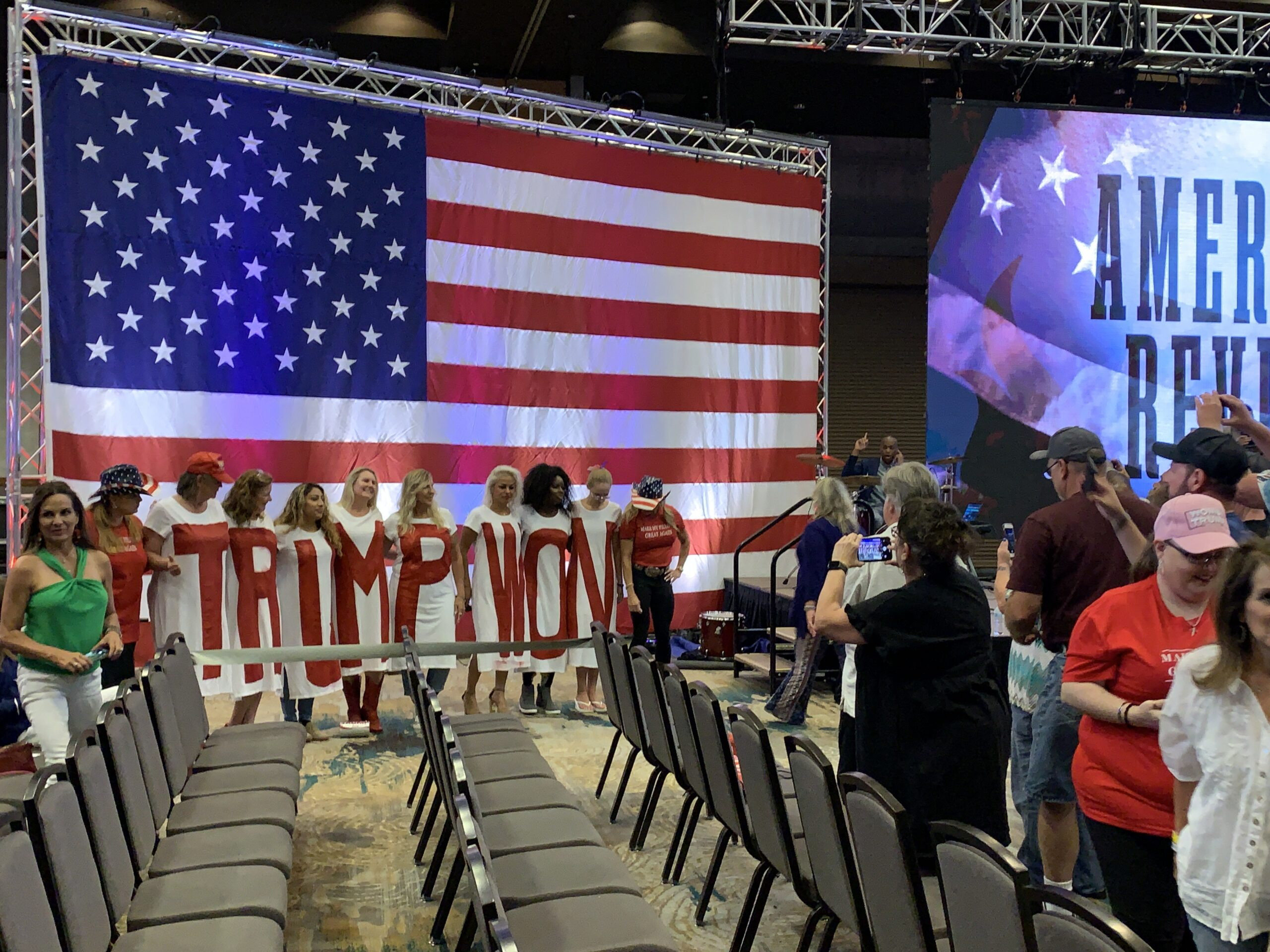 """A group of women is shirts spelling out """"Trump Won"""" pose for photos at the America's Revival event in Frisco, Texas. RNS photo by Bob Smietana"""
