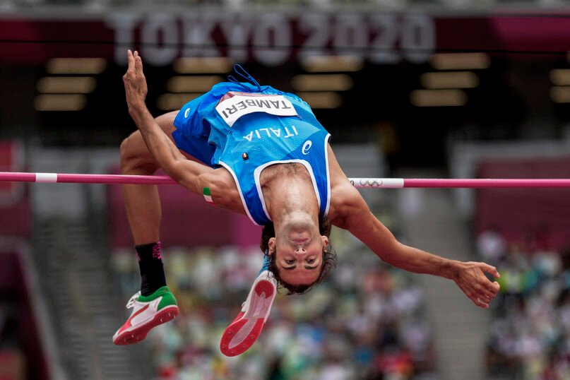 Gianmarco Tamberi, of Italy, competes in the preliminary round of the men's high jump at the 2020 Summer Olympics, July 30, 2021, in Tokyo. (AP Photo/David J. Phillip)