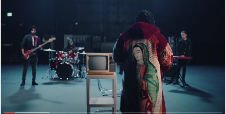 Several celebrities have been seen wearing coats designed by Brenda Equihua, with an image of Mary displayed at the back. (Screen grab from Shelley FKA DRAM - Exposure (Official Music Video))