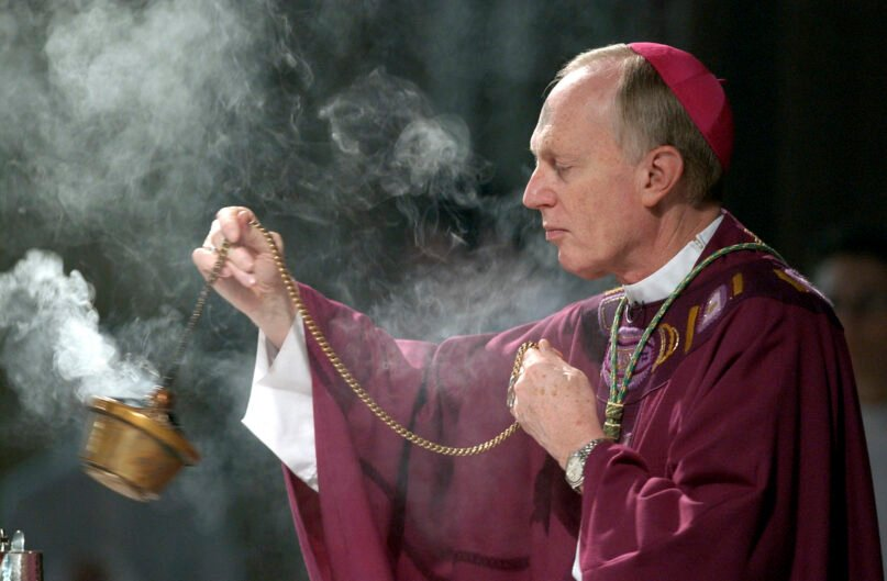 FILE - This photo from Wednesday Feb. 25, 2004, shows Bishop Howard Hubbard swinging incense during an Ash Wednesday communion service at the Cathedral of the Immaculate Conception in Albany, N.Y. Hubbard, the former longtime head of the Roman Catholic Diocese of Albany, says the diocese covered up sexual abuse by priests for decades and protected clergy by sending them to private treatment instead of calling police. (AP Photo/Jim McKnight, File)