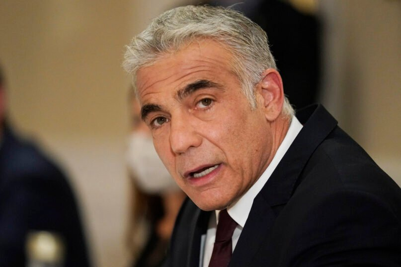 In this June 27, 2021, file photo, Israeli Foreign Minister Yair Lapid meets with Secretary of State Antony Blinken in Rome. Poland's government said Aug. 16, 2021, that its ambassador to Israel will remain in Poland until further notice after Israel downgraded diplomatic ties with Warsaw and strongly criticized a new Polish law that restricts the rights of Holocaust survivors to reclaim property seized by the country's former communist regime. (AP Photo/Andrew Harnik, Pool, File)