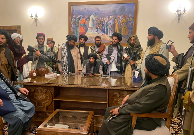 Taliban fighters take control of the Afghan presidential palace after President Ashraf Ghani fled the country, in Kabul, Afghanistan, Aug. 15, 2021. (AP Photo/Zabi Karimi)