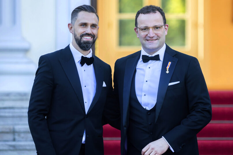 In this July 5, 2021, file photo, German Health Minister Jens Spahn, right, and his husband, Daniel Funke, arrive at Bellevue presidential palace to attend a state banquet hosted by the federal president and his wife in Berlin. Spahn, who has been an ever-present appearance in the country's media and public since the outbreak of the coronavirus pandemic, has criticized the Catholic Church for its refusal to bless same-sex couples. (AP Photo/Christoph Soeder)