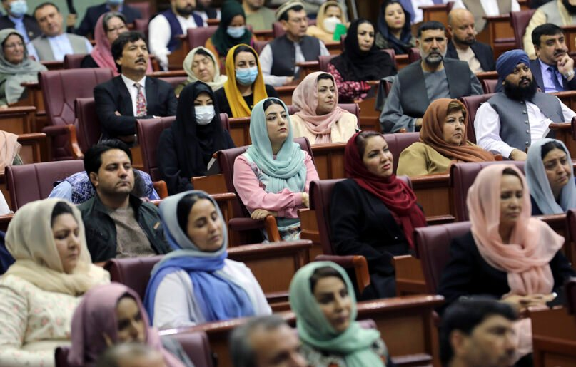 Afghan Parliament members listen to a speech by President Ashraf Ghani during an extraordinary meeting of the Parliament in Kabul, Afghanistan, Aug. 2, 2021. (AP Photo/Rahmat Gul)