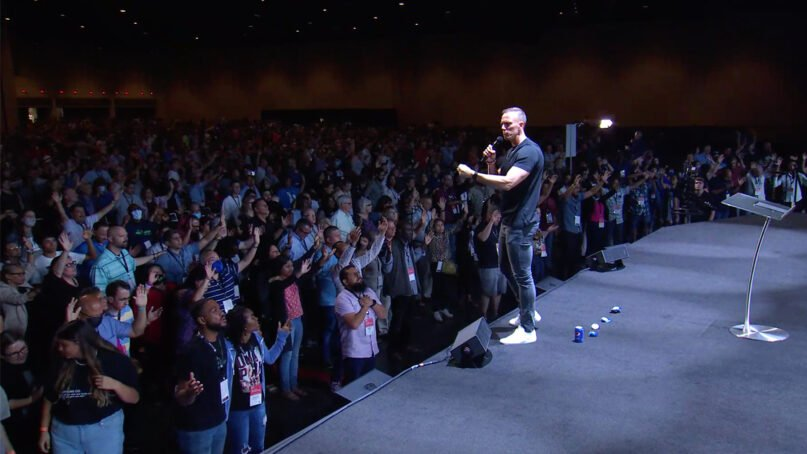 Aaron Burke, lead pastor of Radiant Church in Tampa, Florida, delivers the main address at the Aug. 3, 2021, evening session of the Assemblies of God Influence Conference at General Council 2021 in Orlando, Florida. Video screen grab