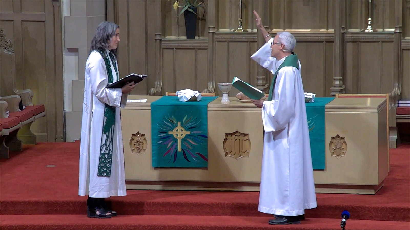 The Rev. Nadia Bolz-Weber, left, is installed as Pastor of Public Witness, Friday, Aug. 20, 2021, by Bishop Jim Gonia, right, of the Rocky Mountain Synod of the ELCA, in a service at Montview Boulevard Presbyterian Church in Denver, Colorado. Video screengrab