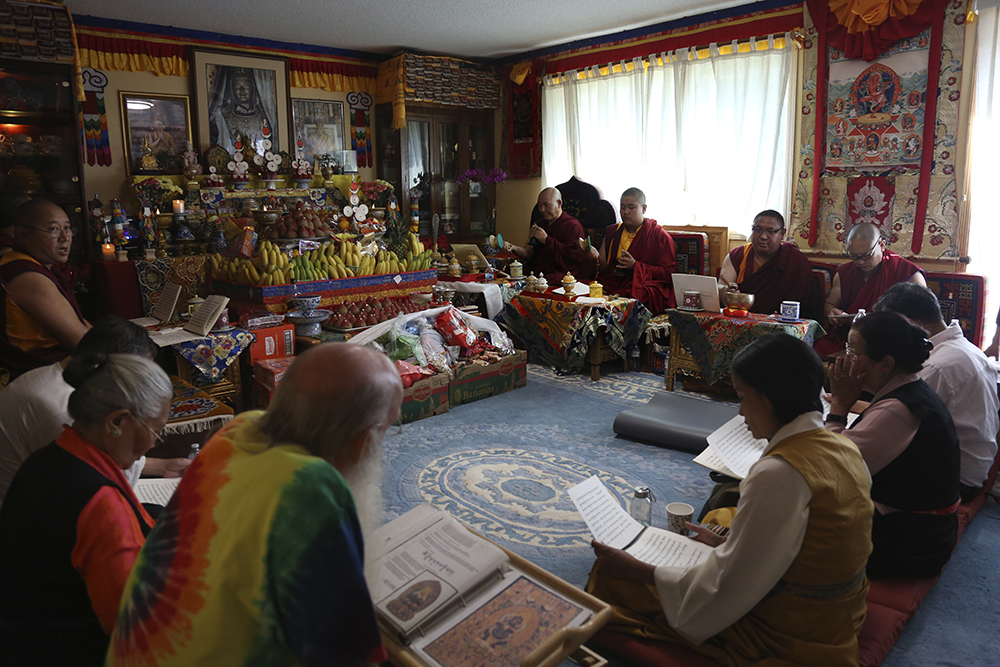 Jalue Dorje and his fellow monks pray during a ceremony paying homage to Guru Rinpoche, the Indian Buddhist master who brought Tantric Buddhism to Tibet, at Dorje's home in Columbia Heights, Minn., on Monday, July 19, 2021. Over two days the group prayed for victims of natural disasters, war and COVID-19, and for the peace and happiness of beings worldwide. (AP Photo/Jessie Wardarski)