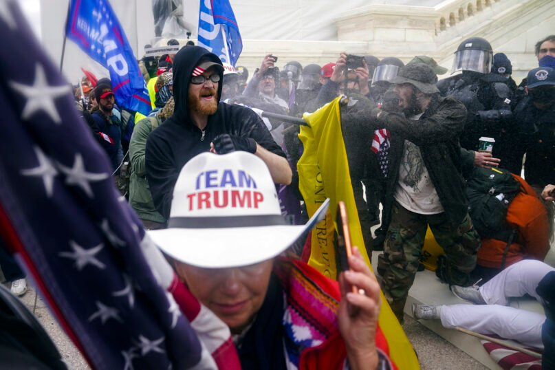 Trump supporters try to break through a police barrier, Wednesday, Jan. 6, 2021, at the Capitol in Washington. As Congress prepared to affirm President-elect Joe Biden's victory, thousands of people gathered to show their support for President Donald Trump and his claims of election fraud. (AP Photo/John Minchillo)