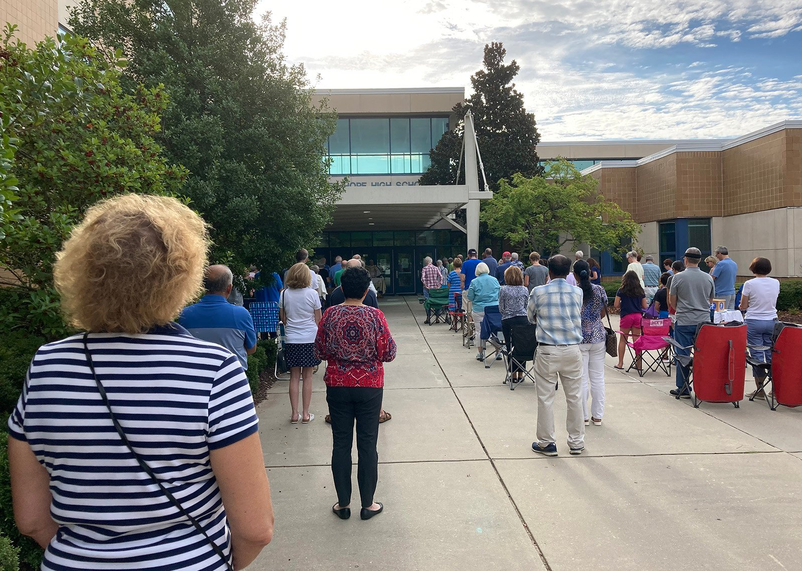 Mother Teresa Catholic Church congregants bring their own chairs for Mass outside Green Hope High School in Cary, North Carolina, early Sunday, Aug. 15, 2021. RNS photo by Yonat Shimron