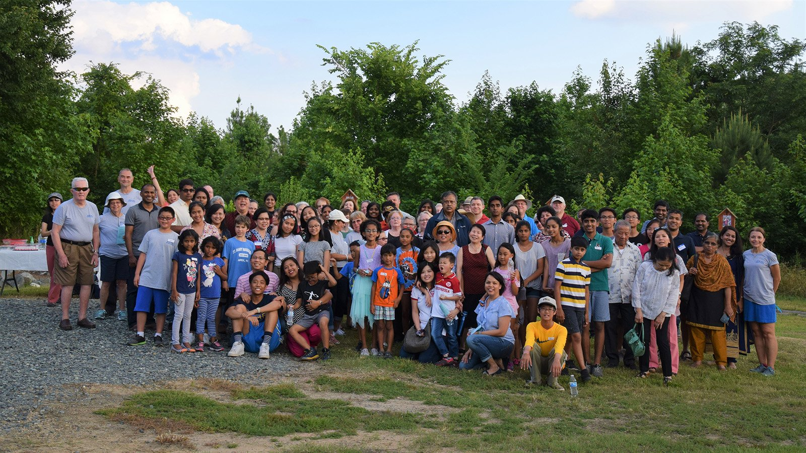 Mother Teresa Catholic Church members pose for a group photo during a Multicultural Rosary event in 2018 at the future church site in Cary, North Carolina. Attendees prayed the decades of the rosary in different languages, reflecting their different backgrounds. Photo courtesy of Mother Teresa Catholic Church