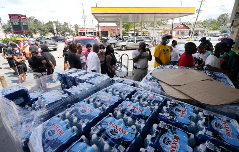 Customers stand in line to shop at a convenience store with no electricity after Hurricane Ida knocked out power in the area, Aug. 30, 2021, in New Orleans. (AP Photo/Eric Gay)