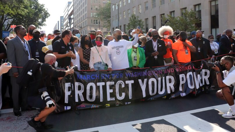 The Rev. Al Sharpton, center, and Yolanda Renee King, to his right, prepare to start March On for Voting Rights in Washington, DC, on August 28, 2021. RNS photo by Adelle M. Banks