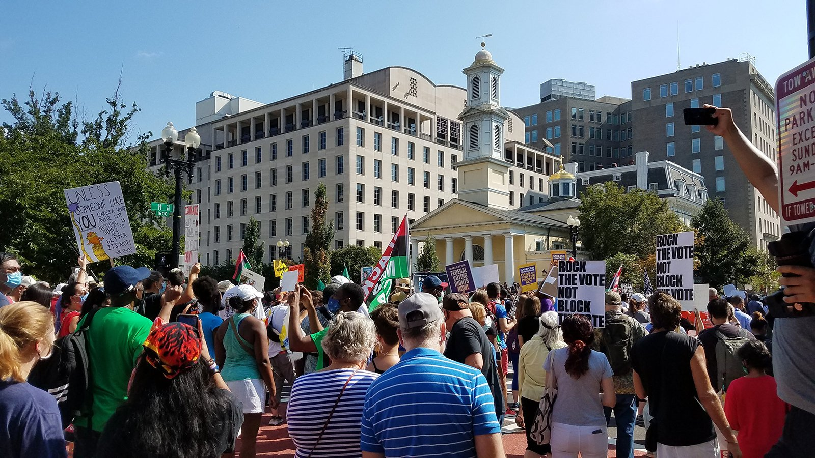 Participants in March On for Voting Rights pass Black Lives Matter Plaza and St. John's Episcopal Church, Saturday, Aug. 28, 2021, in Washington, DC. RNS photo by Adelle M. Banks