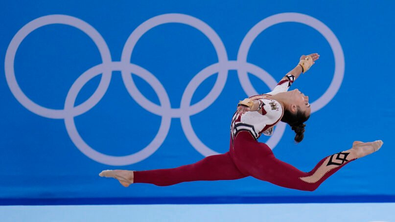 In this July 25, 2021, file photo, Pauline Schaefer-Betz, of Germany, performs her floor exercise routine during the women's artistic gymnastic qualifications at the 2020 Summer Olympics, in Tokyo. The German gymnastics team wore full-legged unitards that went down to the gymnasts' ankles, eschewing the traditional bikini cut that ends high on the hip. The athletes said they were trying to combat the sexualization of young women and girls in their sport. (AP Photo/Gregory Bull, File)