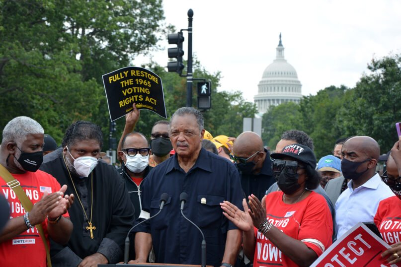 The Rev. Jesse Jackson, center, speaks during a Poor People's Campaign demonstration in Washington, Monday, Aug. 2, 2021. RNS photo by Jack Jenkins