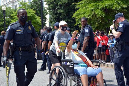 Activists are arrested during a Poor People's Campaign demonstration in Washington, Monday, Aug. 2, 2021. RNS photo by Jack Jenkins
