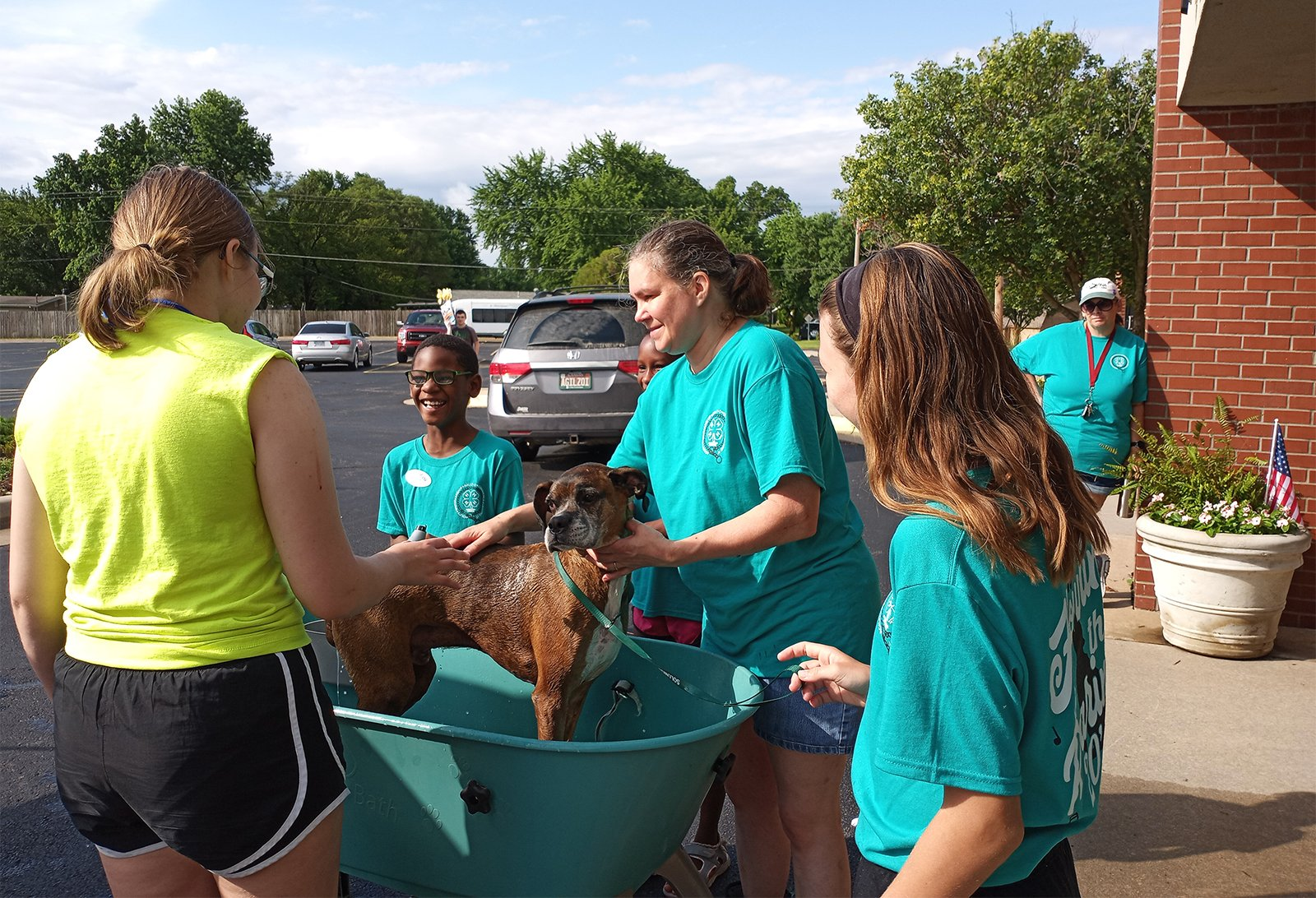 The Sedgwick County 4H Team washes a dog during an Operation Saint Francis event at Woodlawn UMC in Derby, Kasas, Satuday, June 26, 2021. Photo courtesy of Carla Stroot