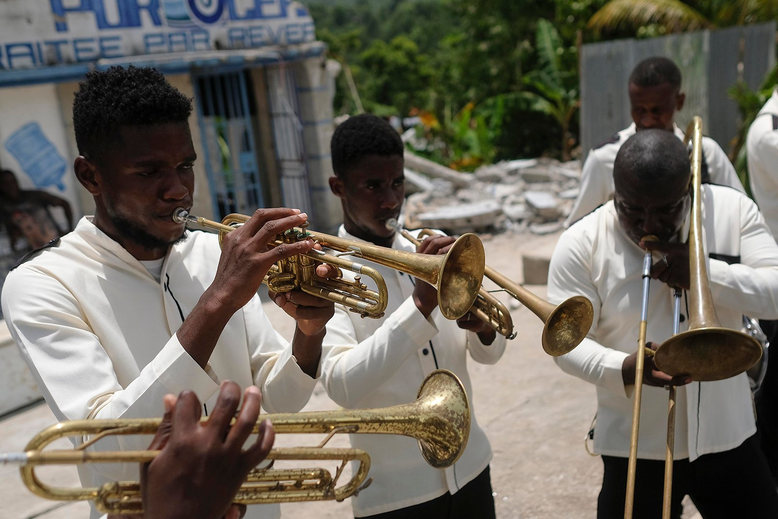 A band plays during the funeral of Baptist church minister Andre Tessono, who was killed during the 7.2 magnitude earthquake that hit the area eight days ago, in the Picot neighborhood in Les Cayes, Haiti, Sunday, Aug. 22, 2021. (AP Photo/Matias Delacroix)