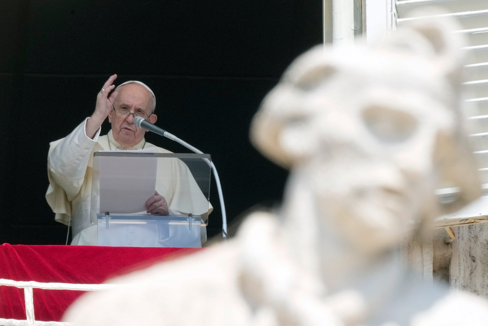 """Pope Francis delivers his blessing as he recites the Angelus noon prayer from the window of his studio overlooking St. Peter's Square, at the Vatican, Sunday, Aug. 15, 2021. The pontiff said he shares """"the unanimous concern for the situation in Afghanistan'' and expressed his closeness to the people of Haiti following Saturday's 7.2-magnitude quake. (AP Photo/Andrew Medichini)"""