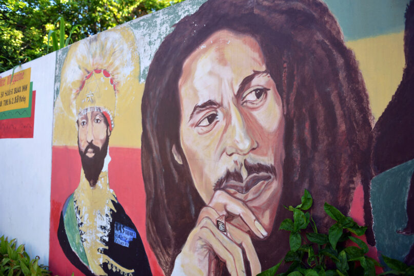 A mural depicting reggae music icon Bob Marley, right, and former Ethiopian Emperor Haile Selassie decorate a wall in the yard of Marley's Kingston home, in Jamaica, Wednesday, Feb. 6, 2013. (AP Photo/ David McFadden)