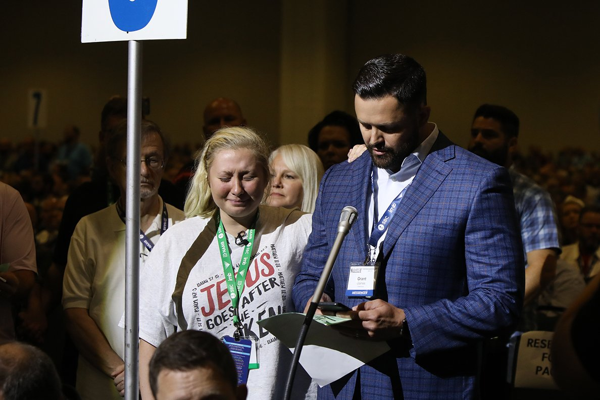 Sexual assault victim Hannah-Kate Williams, center left, accompanies Tennessee pastor and messenger Grant Gaines as he introduces a motion for a sexual abuse task force during the Southern Baptist Convention annual meeting, Tuesday, June 15, 2021, in Nashville, Tennessee. RNS photo by Kit Doyle