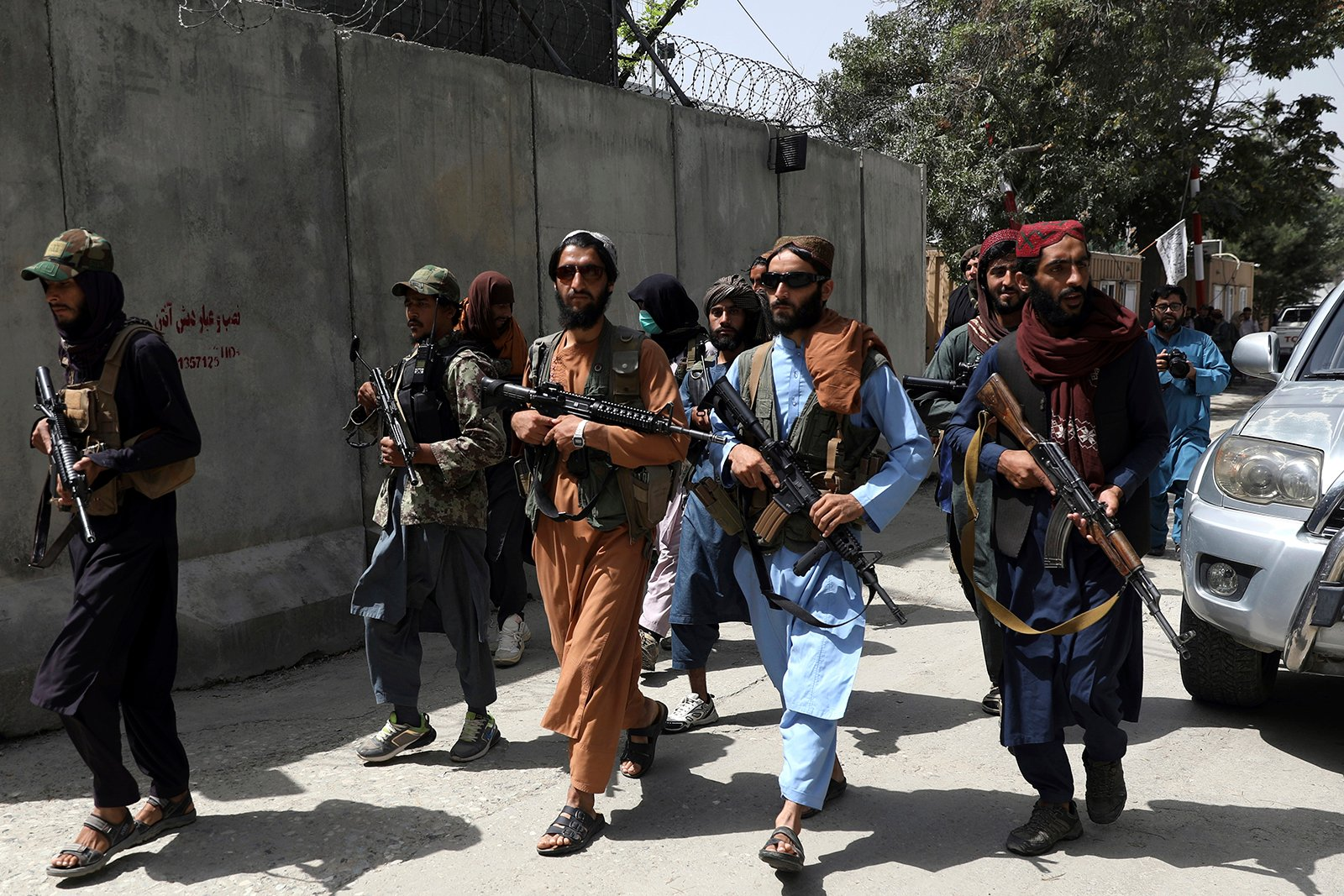 """Taliban fighters patrol in the Wazir Akbar Khan neighborhood of Kabul, Afghanistan, on Aug. 18, 2021. The Taliban declared an """"amnesty"""" across Afghanistan and urged women to join their government Tuesday, seeking to convince a wary population that they have changed a day after deadly chaos gripped the main airport as desperate crowds tried to flee the country. (AP Photo/Rahmat Gul)"""